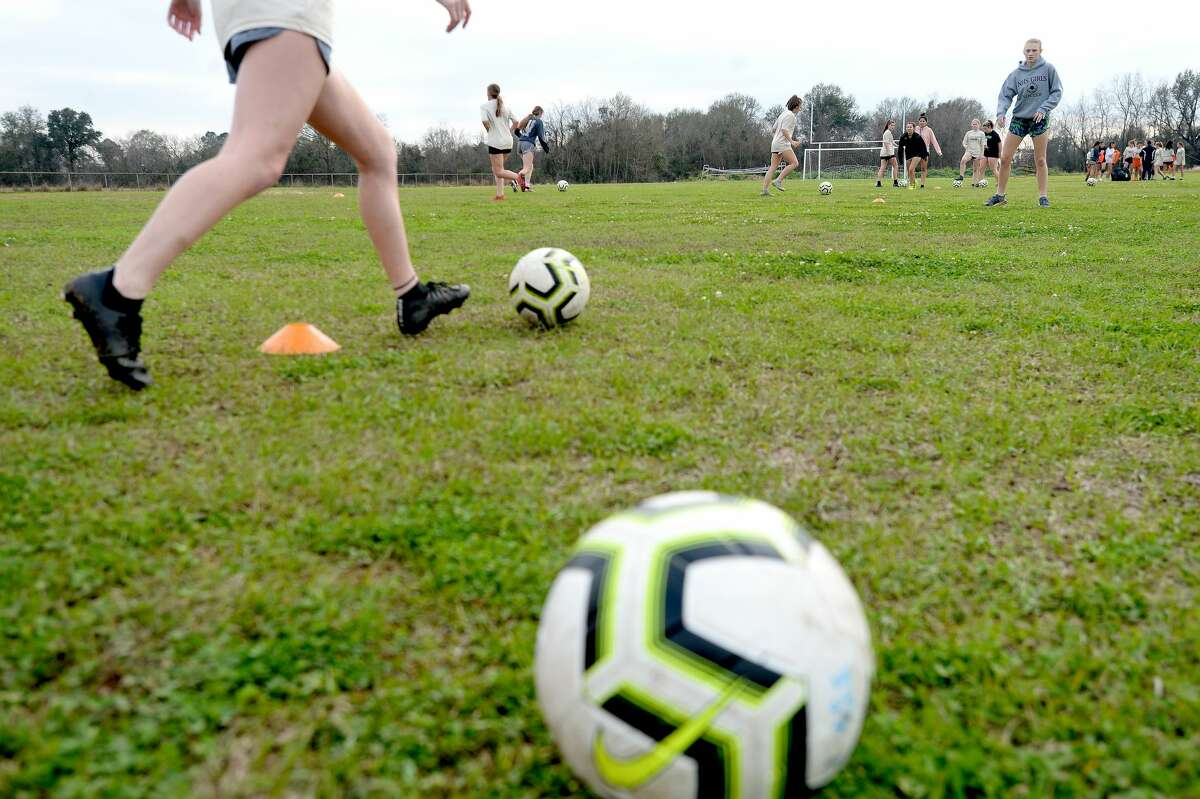 Members of the Nederland girls soccer team get in practice Monday as they prepare for an upcoming district game. The Lady Bulldogs are looking to maintain their record of claiming the district title this season. Photo taken Monday, Jan. 27, 2020 Kim Brent/The Enterprise
