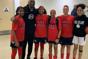 """Aniah Alewine (far right) and teammates cornered Kobe Bryant into a photo op.   """"After game one, how awesome is this? Hoop dreams coming true and it's just the beginning! Note that Aniah was the only one in a different color, she had already changed for the next game, lol!"""""""