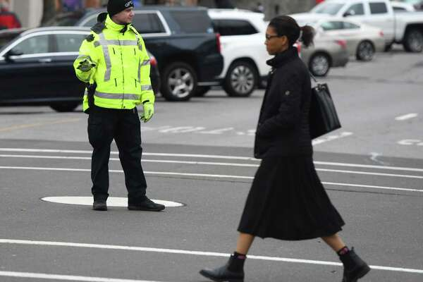 A Greenwich Police Officer directs traffic at the intersection of Greenwich Avenue and Elm Street in Greenwich, Conn. Tuesday, Jan. 28, 2020. First Selectman Fred Camillo proposed the elimination of the longtime tradition of traffic cops along Greenwich Avenue, which he estimated a cost savings of more than $250,000 per year.