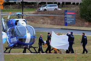 A Life Star helicopter crew prepares to transport Fotis Dulos to a Hospital in New York City from UConn Heath in Farmington, Conn., on Tuesday Jan. 28, 2020.