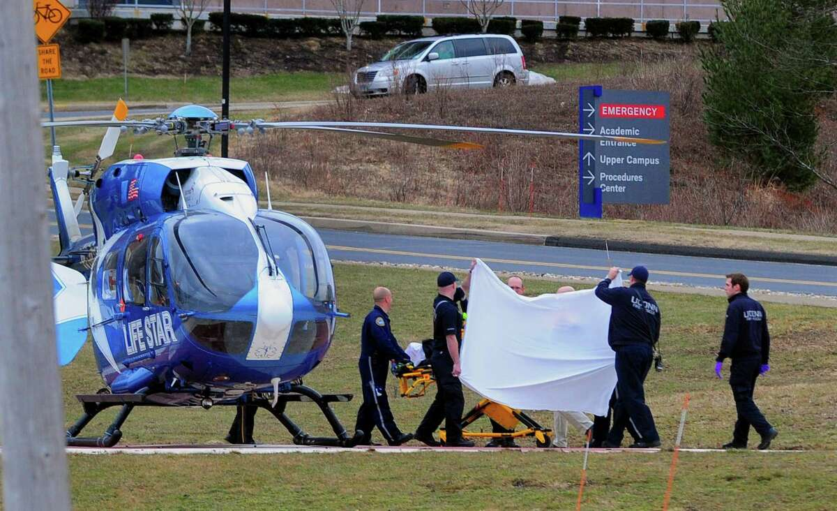 A Life Star helicopter crew prepares to transport Fotis Dulos to Bridgeport Hospital from UConn Heath in Farmington, Conn., on Tuesday Jan. 28, 2020.