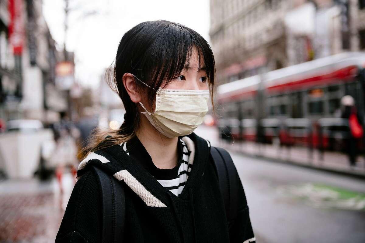 City college student Ziemi Chen wears a filter mask because of fears over the coronavirus outbreak, in San Francisco, Calif, on Tuesday, January 28, 2020.