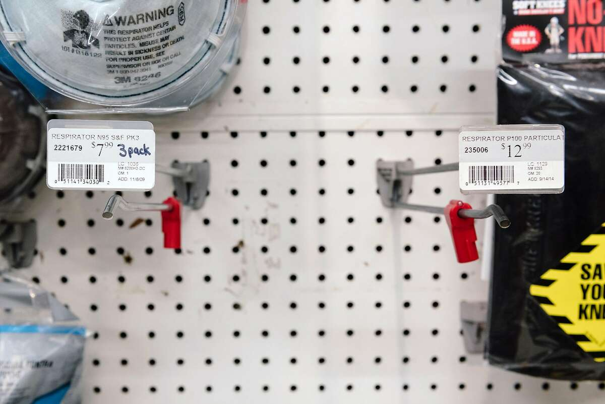 Empty racks for N95 and P100 filter masks are seen at the downtown location of Cole Hardware after they sold out, in San Francisco, Calif, on Tuesday, January 28, 2020.