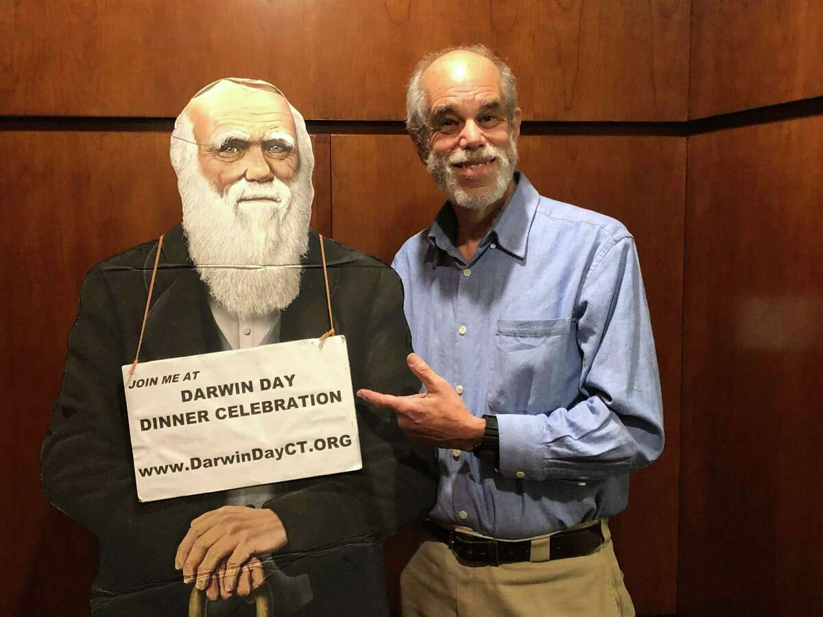 Cary Shaw shows off Charles Darwin in anticipation of the annual Darwin Day dinner in Stamford on Feb. 8.