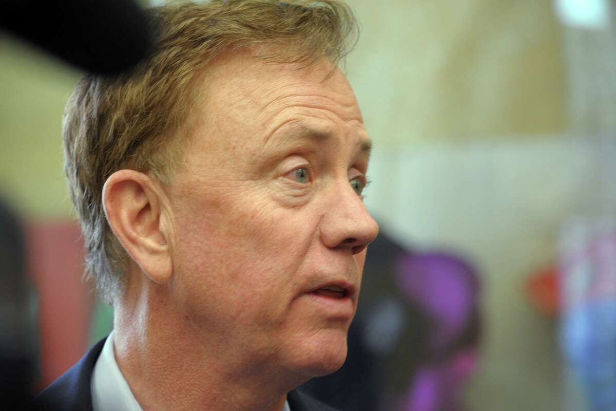Gov. Ned Lamont speaks to reporters following a news conference at the South Norwalk train station, in Norwalk, Conn. Jan. 6, 2020.