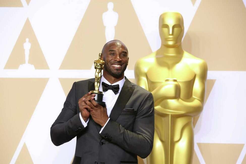 FILE -- Kobe Bryant after winning best animated short film for