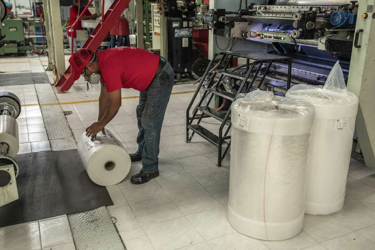 An employee prepares a roll of plastic bags for printing at the Bolsiflex SA manufacturing facility in Mexico City, Mexico, on Tuesday, Jan. 14, 2020. According to the National Association of the Plastic Industry (Anipac), single-use products account for 47% of the plastic industry in Mexico, which is worth US $30 billion and directly employees 260,000 people.