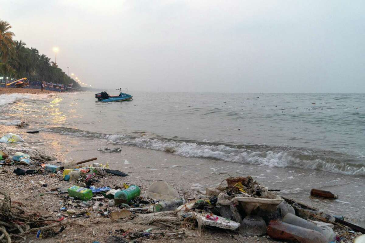Trash sits along the shore at Bangsaen beach in Chon Buri, Thailand, on Sunday, Jan. 19, 2020. Thailand's love of plastic bags helped make it the sixth-worst maritime polluter. The country generates more than 5,000 metric tons of plastic trash a day, three-quarters of which ends up in landfills.
