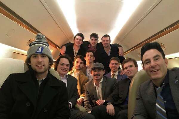 The Albertus Magnus hockey team took a charter fight from New Haven toNew York's North Country.