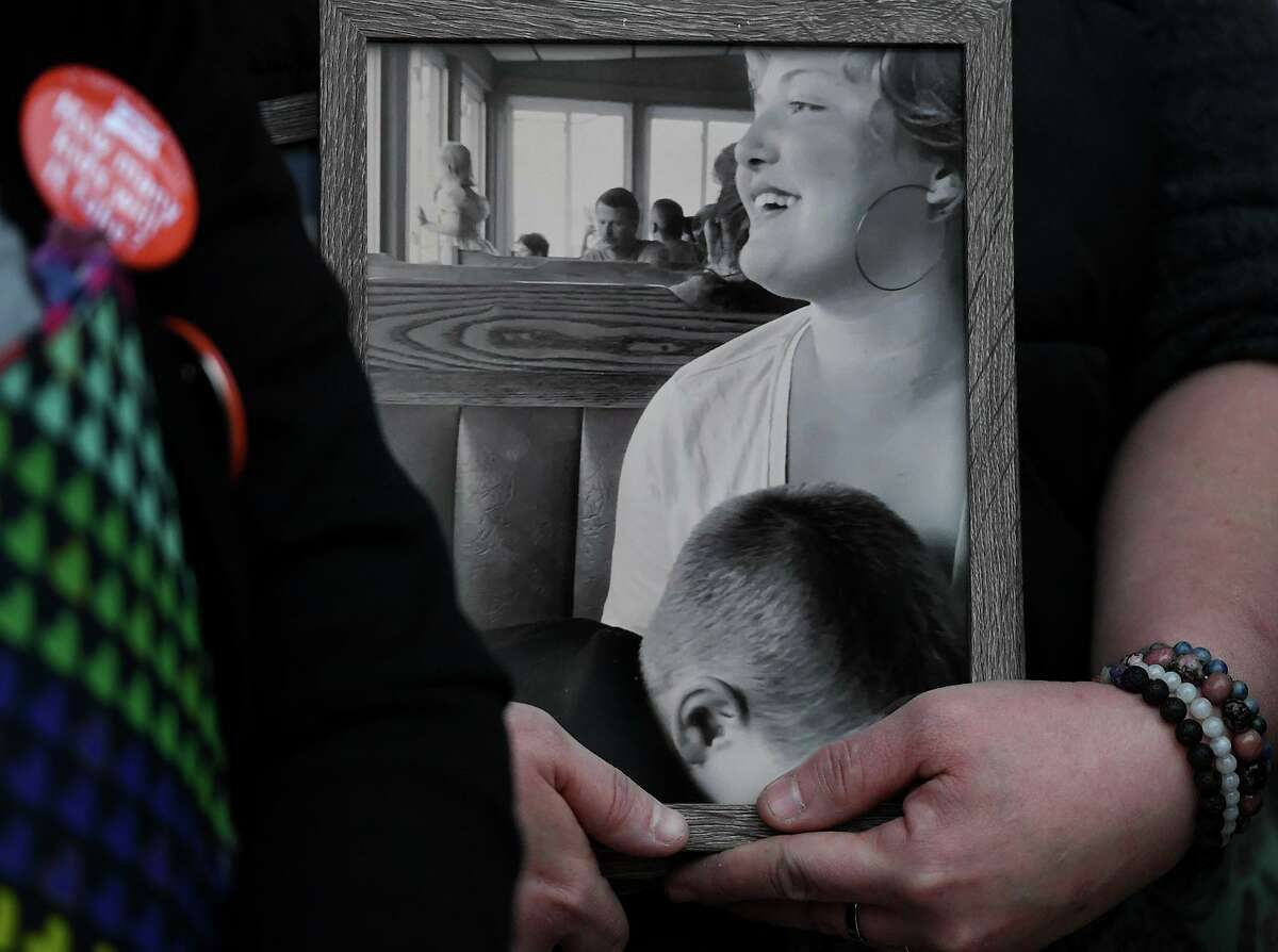 A photo of murder victim Emily Todd, from Bethel, is held by her aunt Carrie Delaney following a plea hearing for accused murderer Brandon Roberts outside Superior Court in Bridgeport, Conn. on Tuesday January 28, 2020. The court rejected Roberts' offer to plead guilty in return for a forty-five year sentence.