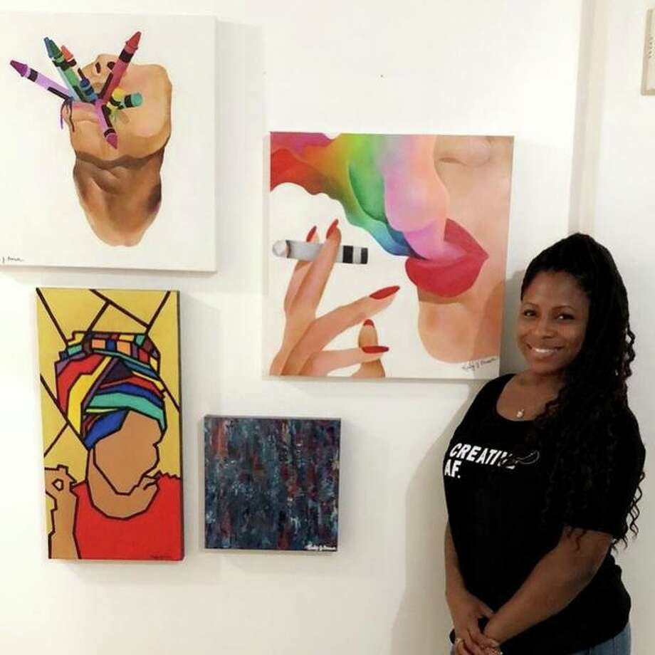 A local artist shows off her work at the first annual RISE Exhibition celebrating artists of color in the greater St. Louis area. Photo: Photo Courtesy Of Shelby Clayton
