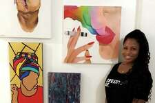 A local artist shows off her work at the first annual RISE Exhibition celebrating artists of color in the greater St. Louis area.