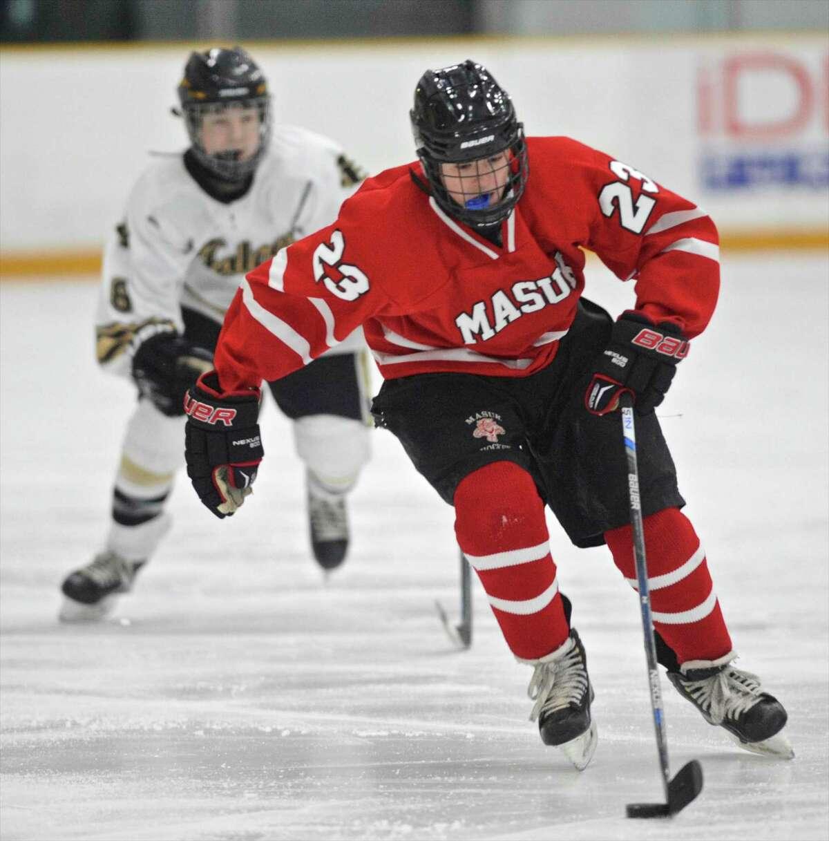 Masuk's Kyle Cirillo (23) brings the puck up-ice ahead of Barlow's Evan Baran (8) in the boys high school hockey game between Masuk and Joel Barlow high school on Saturday afternoon, January 14, 2017, at Danbury Ice Arena, Danbury, Conn.