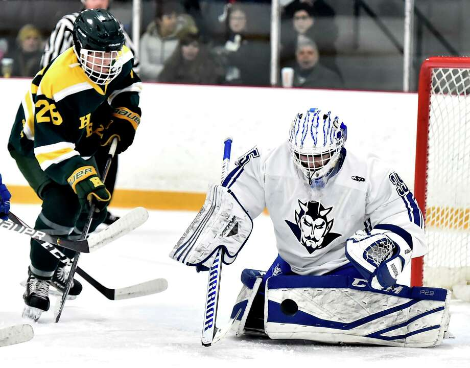 Hamden's Anthony Malonis, left, watches the puck bounce off of West Haven goalie Jared Pliszka during the second period on Jan. 22 at Bennett Rink in West Haven. Photo: Peter Hvizdak / Hearst Connecticut Media / New Haven Register