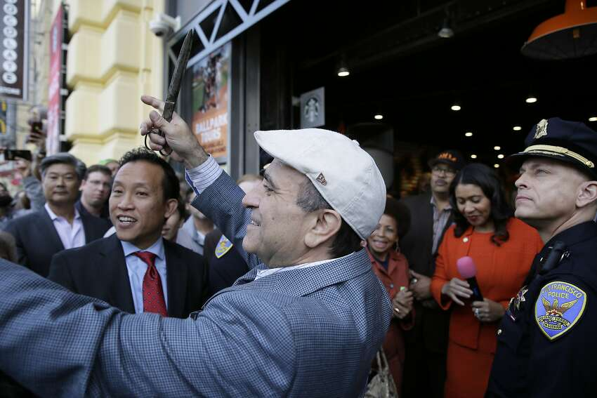 In this Nov. 20, 2018, photo, owner Nick Bovis prepares to cut a ribbon during the opening of Lefty O'Doul's Baseball Ballpark Buffet & Cafe at Fisherman's Wharf in San Francisco. Looking on are state Assemblyman David Chiu (second from left) San Francisco Mayor London Breed (second from right) and city Public Works Director Mohammed Nuru (third from right). Nuru was taken into custody Monday, Jan. 27, 2020, along with Bovis.