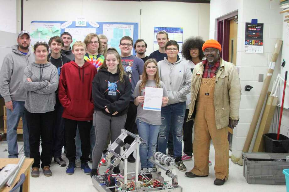 The Brethren High School Robotics team received a letter of encouragement from actor James Earl Jones for their upcoming season. Jones graduated from the Dickson School that later merged into the Kaleva Norman Dickson School District. Presenting the letter was Terry Connolly (far right) who is Jones cousin and lives in the area. (Ken Grabowski/News Advocate)