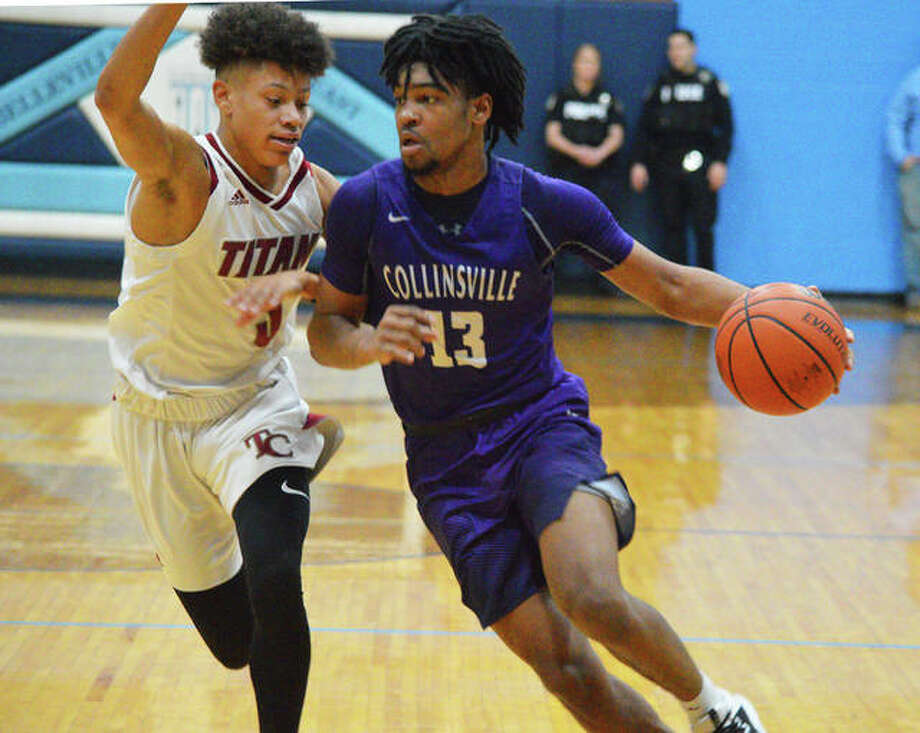 Collinsville senior Ray'Sean Taylor, right, drives to the basket during Saturday's championship game against Trinity Catholic in the Belleville East Classic. Taylor scored a program-record 53 points. Photo: Scott Marion/The Intelligencer