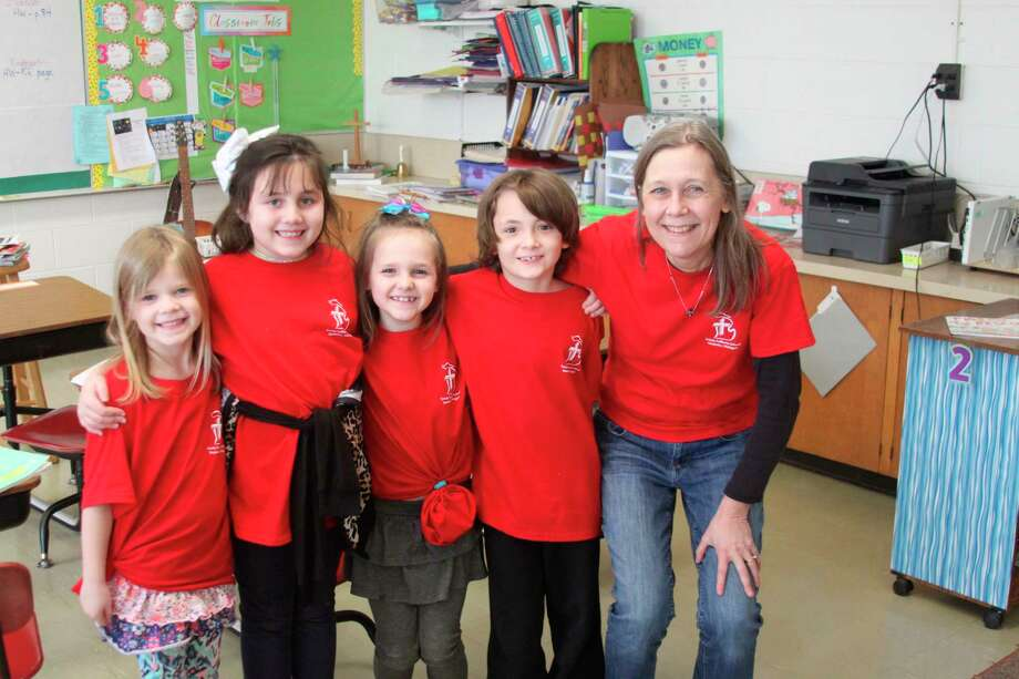 Everyone was seeing red at Trinity Lutheran Schools on Tuesday as staff and students both were sporting red Trinity T-shirts to celebrate Lutheran Schools Week. (Ken Grabowski/News Advocate)