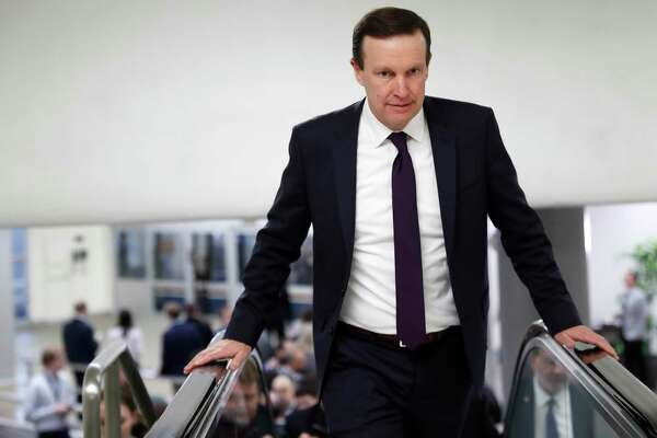 Sen. Chris Murphy, D-Conn., takes an escalator as he heads to attend the impeachment trial of President Donald Trump on charges of abuse of power and obstruction of Congress, Wednesday, Jan. 22, 2020, on Capitol Hill in Washington. (AP Photo/ Jacquelyn Martin)