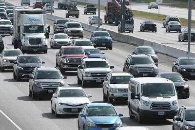 Traffic proceeds along Interstate 35 on the North Side during rush hour on a Friday afternoon in 2018.