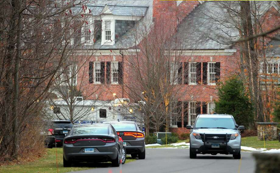 A view of police and crime scene investigation vehicles at Fotis Dulos' home in Farmington, Conn., on Tuesday Jan. 28, 2020. Dulos' was transported from nearby UConn Heath after an apparent suicide attempt. Photo: Christian Abraham / Hearst Connecticut Media / Connecticut Post