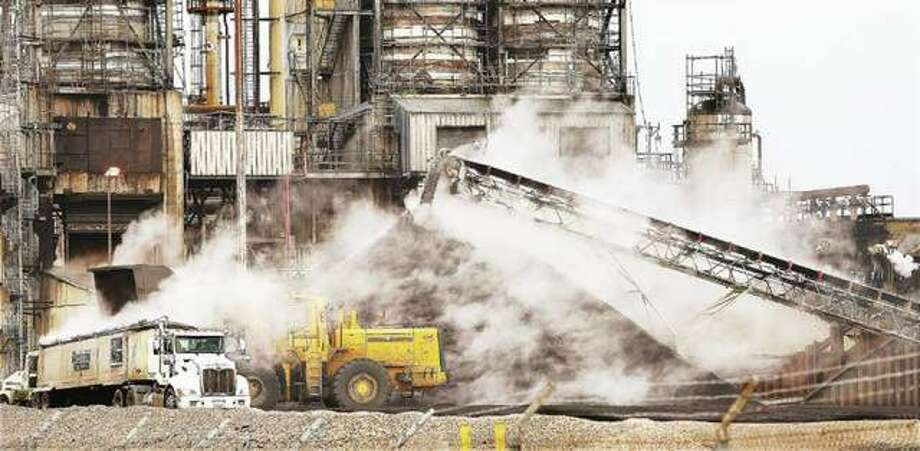 This November 2018 file photo shows a steaming pile of petroleum coke next to a cracking unit at the Valero Energy refinery in Hartford. Photo: John Badman | Telegraph File Photo