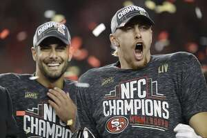 San Francisco 49ers quarterback Jimmy Garoppolo, left, and tight end George Kittle celebrate after the NFL NFC Championship football game against the Green Bay Packers Sunday, Jan. 19, 2020, in Santa Clara, Calif. The 49ers won 37-20 to advance to Super Bowl 54 against the Kansas City Chiefs. (AP Photo/Ben Margot)