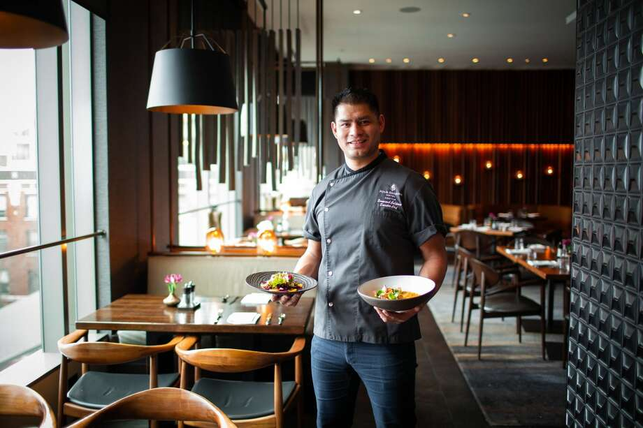 Chef Emmanuel Calderon cooks up Goldfinch Tavern's plant-based menu. Photo: Four Seasons Hotel Seattle