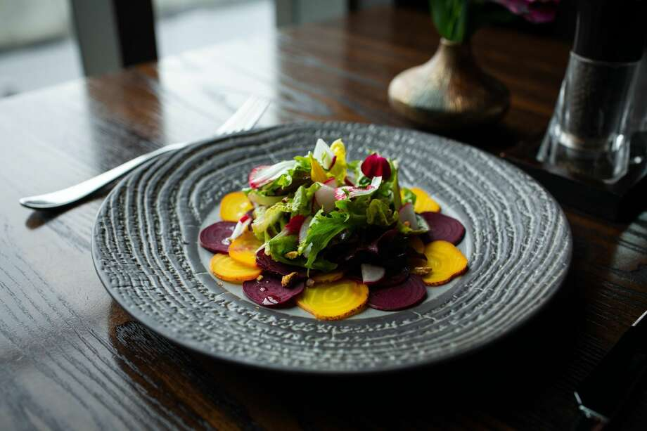 Among many ambitious appetizers, Goldfinch Tavern offers a beet root carpaccio. Photo: Four Seasons Hotel Seattle