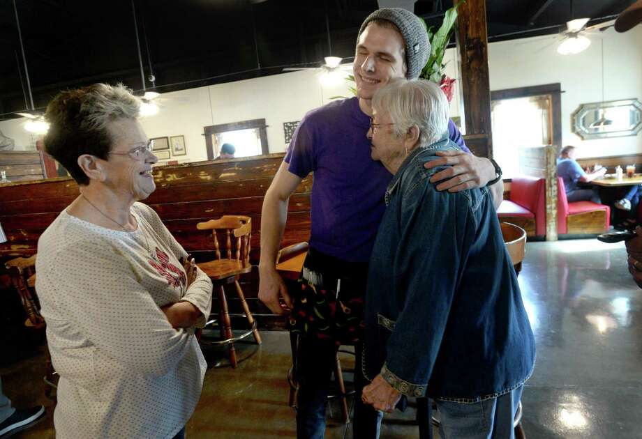 Martha Vautrot looks on as her grandson Rhett Walker, the third generation of famiuly to work at the restaurant, hugs Geri Chute as she and her husband make their way after finishing lunch at Vautrot's Cajun restaurant on its grand reopening Tuesday. The popular Bevil Oaks eatery was destroyed during tropical Storm Harvey and operated out of a food truck while building a new restaurant. Photo taken Tuesday, Jan. 28, 2020 Kim Brent/The Enterprise Photo: Kim Brent / The Enterprise / BEN
