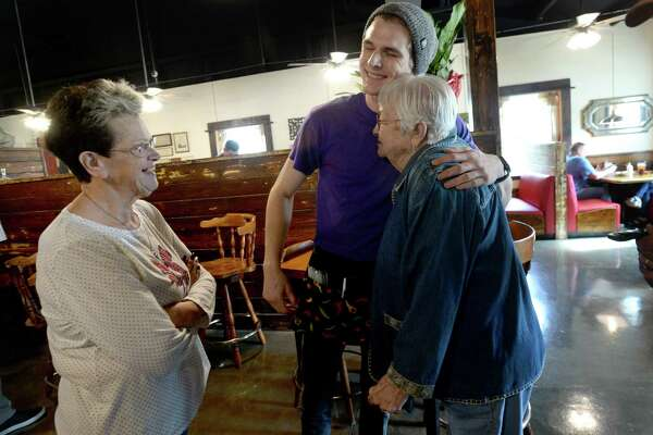 Martha Vautrot looks on as her grandson Rhett Walker, the third generation of famiuly to work at the restaurant, hugs Geri Chute as she and her husband make their way after finishing lunch at Vautrot's Cajun restaurant on its grand reopening Tuesday. The popular Bevil Oaks eatery was destroyed during tropical Storm Harvey and operated out of a food truck while building a new restaurant. Photo taken Tuesday, Jan. 28, 2020 Kim Brent/The Enterprise