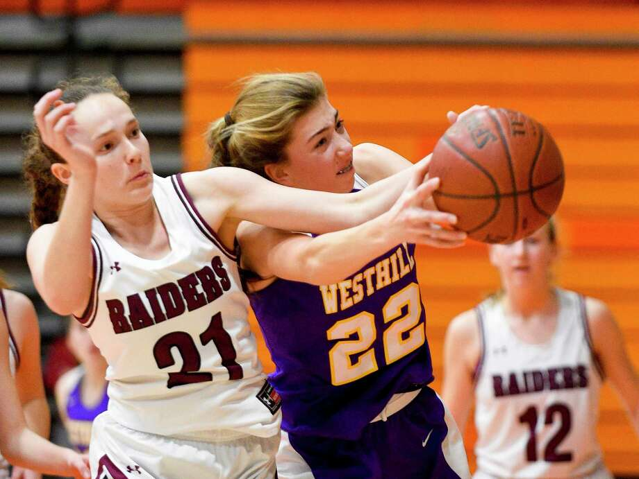 Scarsdale's Isabelle Goldbam (21) and Westhill's Audra Hansen (22) battle for a rebound in the second half of a continuation of a consolation girls basketball game in the 2019 Kuzco Holiday Tournament at Stamford High School on Jan. 28, 2020 in Stamford, Connecticut. The game was halted in the second quarter, just over a month ago, following a medical incident involving one of the referees. Both teams agreed to resumed the contest, picking up where they left off, with the Scarsdale (NY) Raiders topping Westhill 47-40. Photo: Matthew Brown / Hearst Connecticut Media / Stamford Advocate