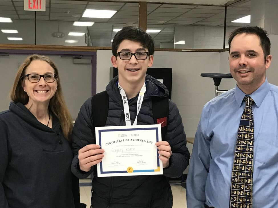 Ballston Spa Middle School GeoBee winner Gregory Kaatz, center, moves on to the New York State competition after winning the school event again this year. He is shown with Ballston Spa Middle Social Studies teachers Carron Blanchet and Ryan Mazierski.