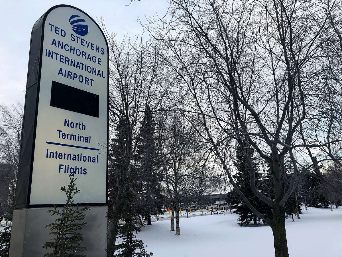 A sign directs travelers to the north terminal at Ted Stevens Anchorage International Airport in Anchorage, Alaska, where a flight plane carrying U.S. citizens being evacuated from Wuhan, China is expected later Tuesday, is seen Tuesday, Jan. 28, 2020. (AP Photo/Mark Thiessen)