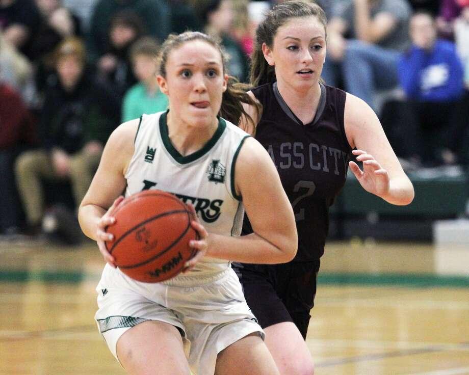 The Cass City girls basketball team edged host Laker, 51-47, on Tuesday night. Photo: Mark Birdsall/Huron Daily Tribune
