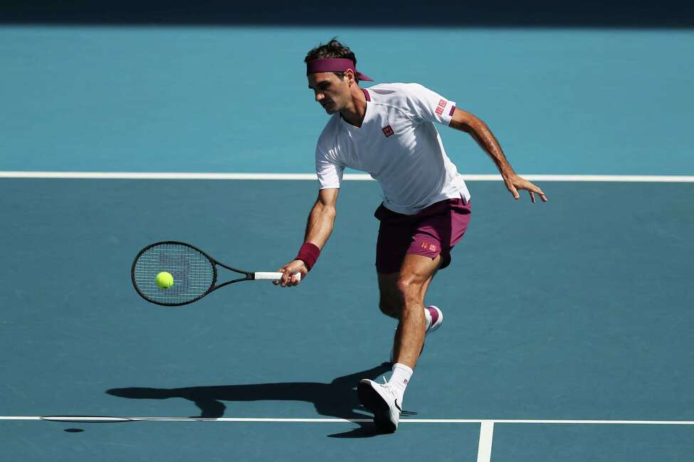 MELBOURNE, AUSTRALIA - JANUARY 28: Roger Federer of Switzerland plays a forehand during his Mens Singles Quarterfinal match against Tennys Sandgren of the United States on day nine of the 2020 Australian Open at Melbourne Park on January 28, 2020 in Melbourne, Australia. (Photo by Graham Denholm/Getty Images)