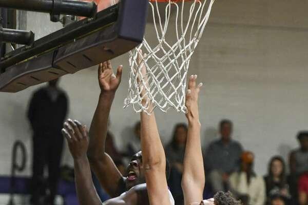 Midland High?•s D?•Morriyon Breaux attempts a basket as Odessa High?•s Chris Blair guards him Tuesday, Jan. 28, 2020 at Midland High School. Jacy Lewis/Reporter-Telegram