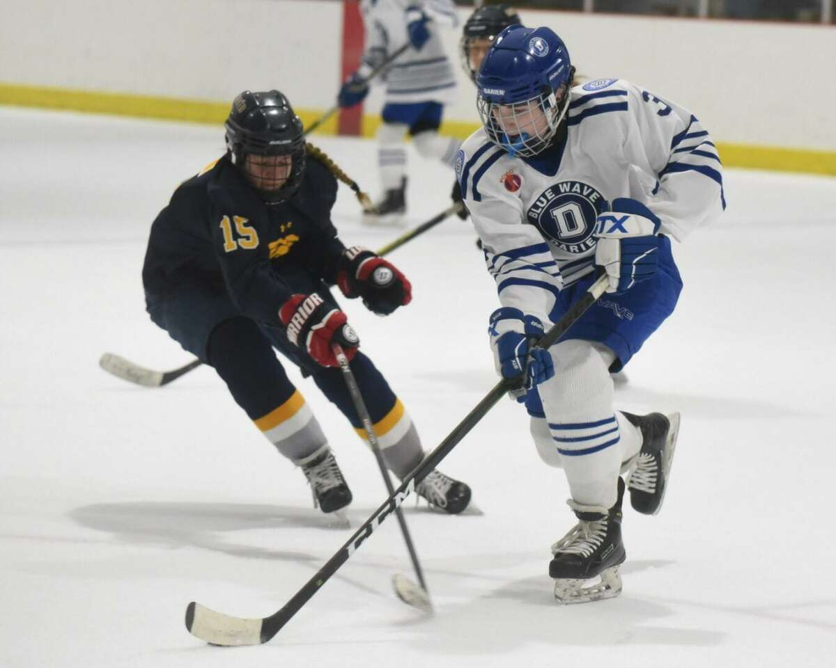 Darien's Catherine Martin (3) controls the puck in the zone while Simsbury's Nicole Loftus (15) pursues during a girls ice hockey game at the Darien Ice House on Tuesday, Jan. 29, 2020.