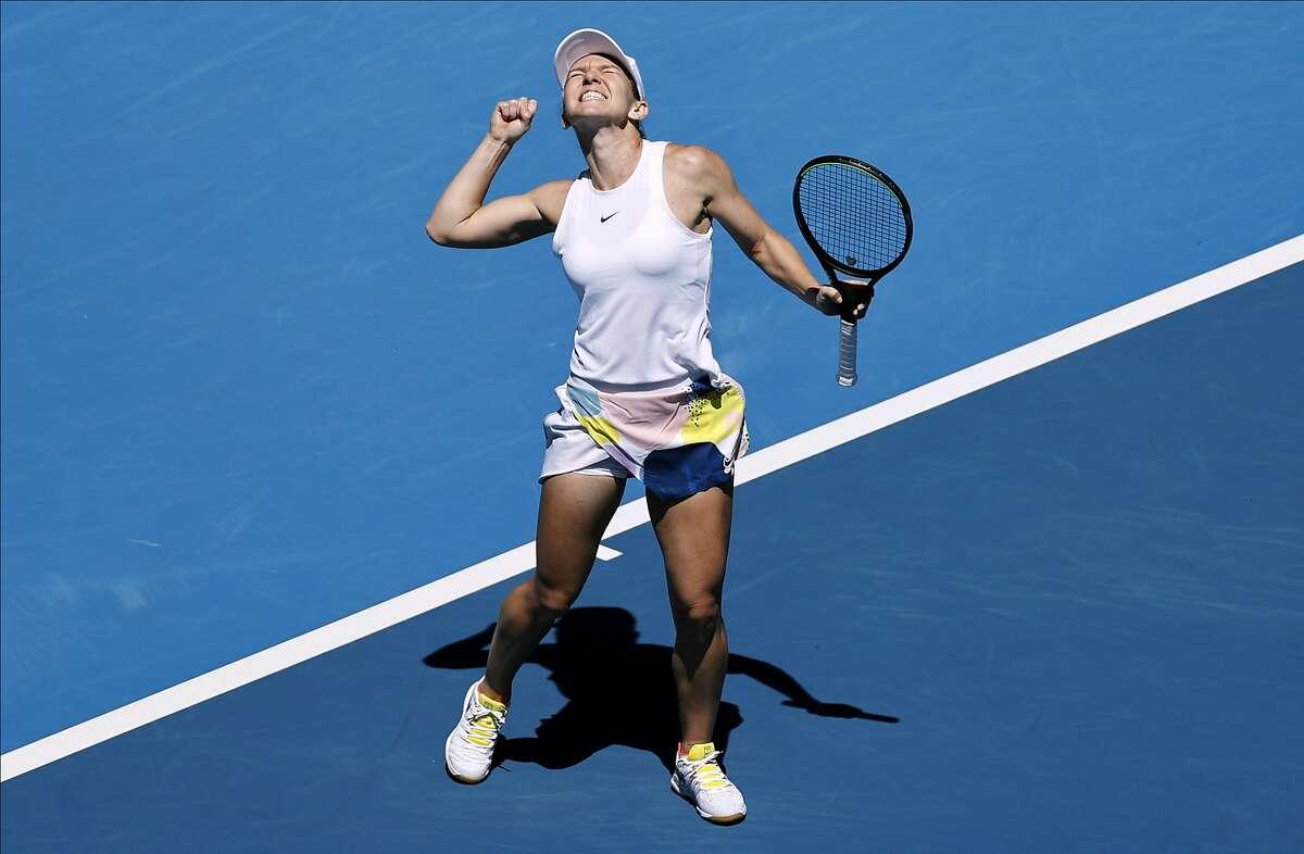 Romania's Simona Halep celebrates after defeating Estonia's Anett Kontaveit during their quarterfinal match at the Australian Open tennis championship in Melbourne, Australia, Wednesday, Jan. 29, 2020. (AP Photo/Dita Alangkara)