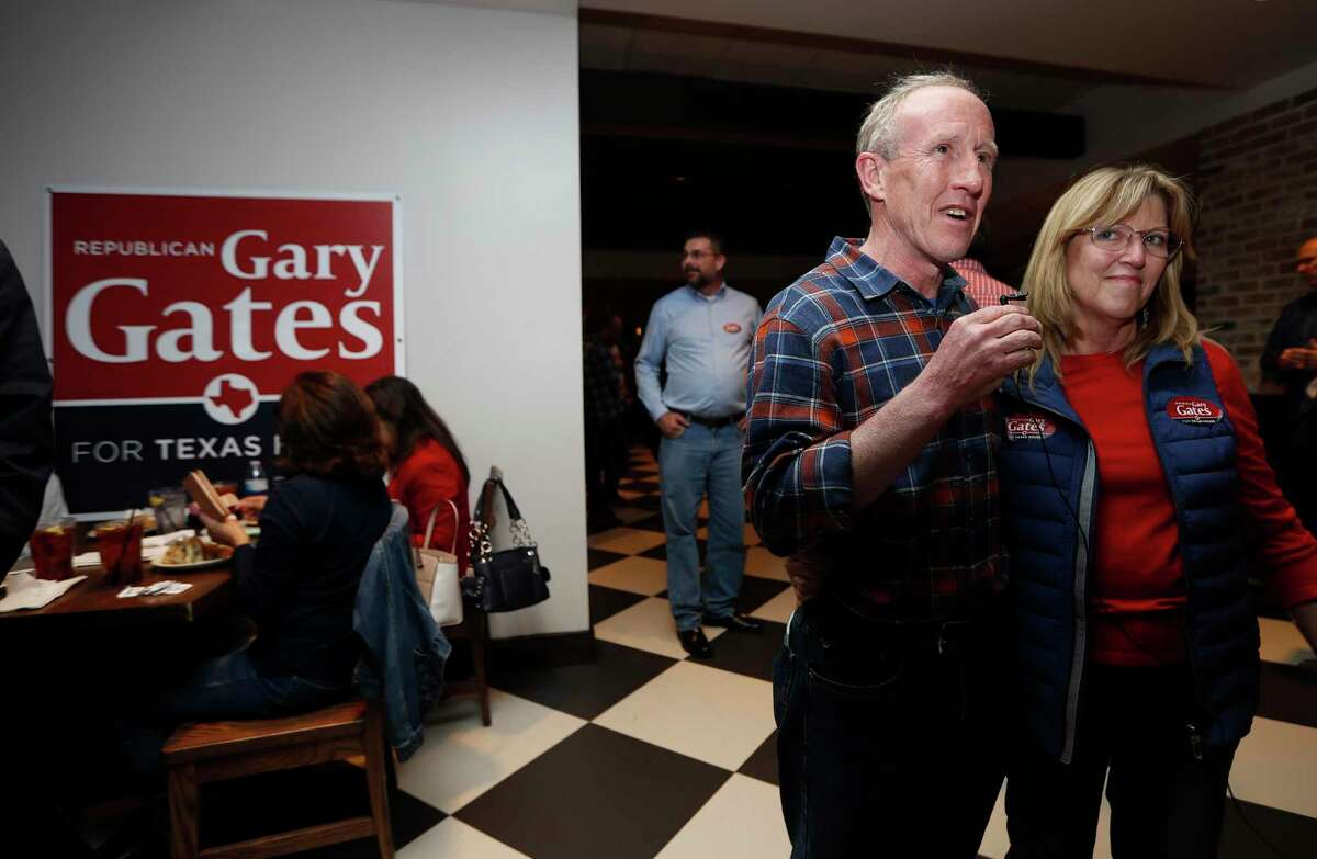 Republican Gary Gates hugs his wife, Melissa at his election night watch party for the House District 28 special election at Gallery Furniture, Tuesday, Jan. 28, 2020, in Richmond.
