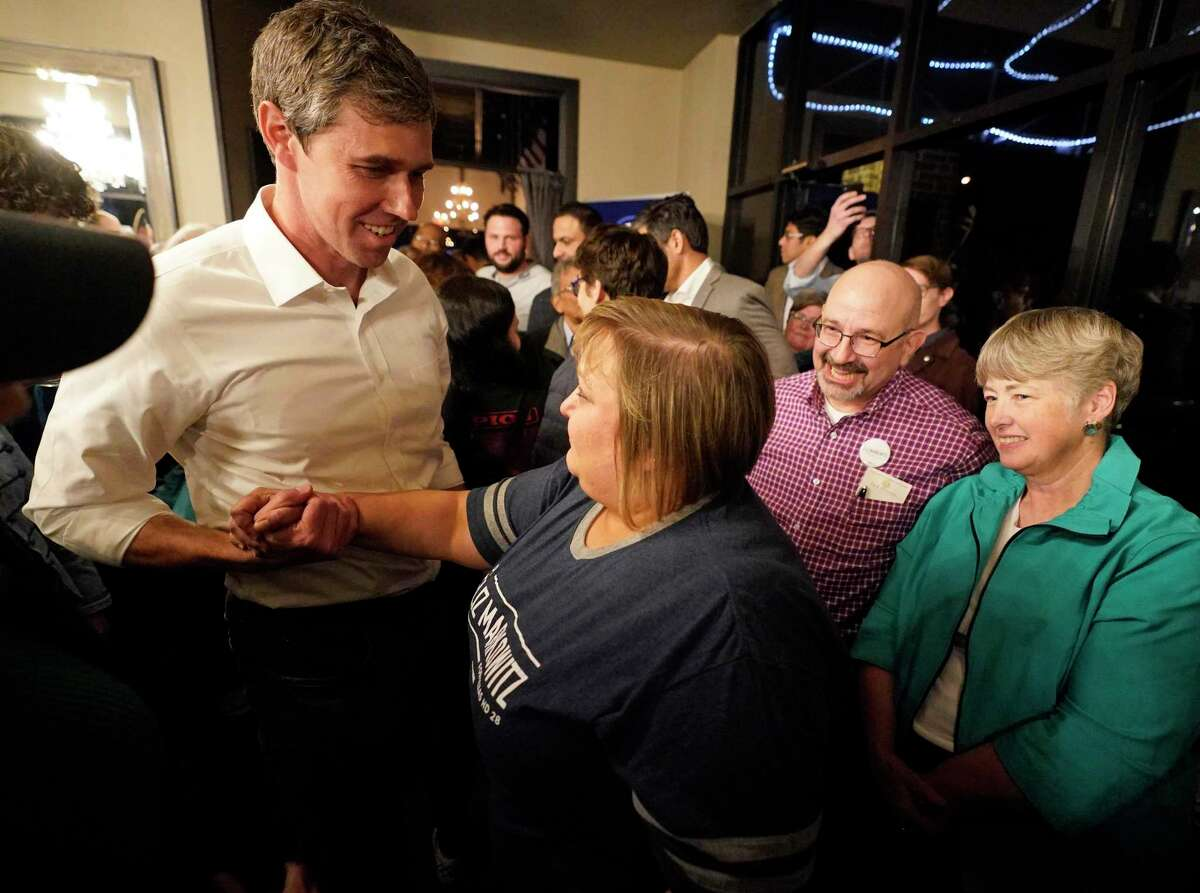 Beto O'Rourke, left, greets Eliz Markowitz, center, as Annise Parker, right, watches during the House District 28 special election watch party for Eliz Markowitz held at Grazia Italian Kitchen, 22764 Westheimer Pkwy., Tuesday, Jan. 28, 2020, in Katy.