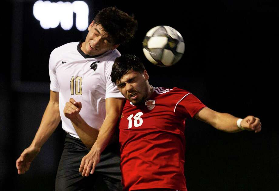 Porter's Carlos Vazquez (10) heads the ball against Caney Creek's Roman Gomez (18) during the first period of a District 20-5A high school soccer match at Buddy Moorhead Stadium, Tuesday, Jan. 28, 2020. Photo: Jason Fochtman, Houston Chronicle / Staff Photographer / Houston Chronicle © 2020