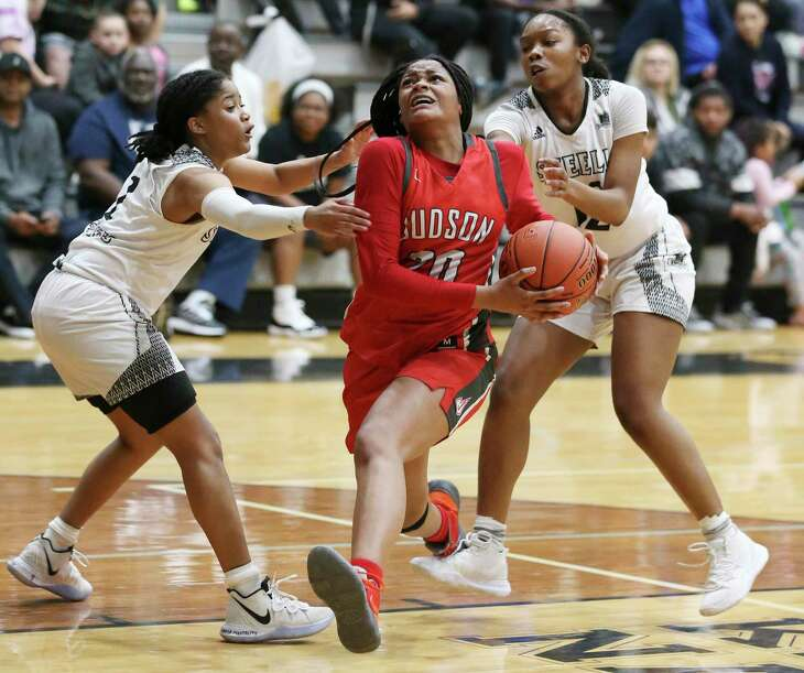 Judson's Kierra Sanderlin (20) drives past Steele's Bria McClure (02) and Aaliyah Ellis (12) during their District 26-6A girls basketball game on Tuesday, Jan. 28, 2020. Judson defeated Steele, 68-44.