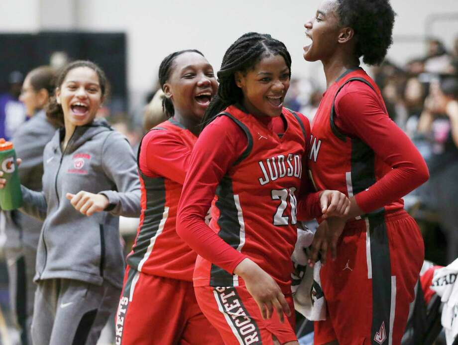 Judson's Amira Mabry (from right), Kierra Sanderlin and Jonmecia Baskin celebrate the closing moments of their District 26-6A girls basketball game against Steele on Tuesday, Jan. 28, 2020. Judson defeated Steele, 68-44. Photo: Kin Man Hui, San Antonio Express-News / Staff Photographer / **MANDATORY CREDIT FOR PHOTOGRAPHER AND SAN ANTONIO EXPRESS-NEWS/NO SALES/MAGS OUT/ TV OUT