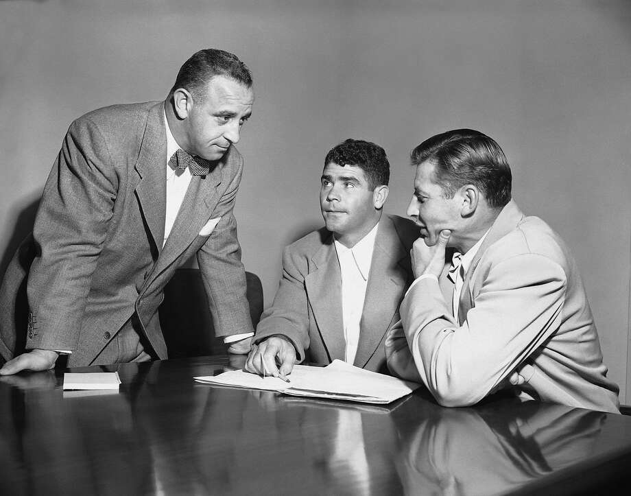 Tony Morabito, left, co-owner of the 49ers, confers on Nov. 30, 1949 in San Francisco with player spokesmen Norm Standle, center, and Len Eshmont concerning proposed strike for bonus pay for play off games. Photo: Clh, AP