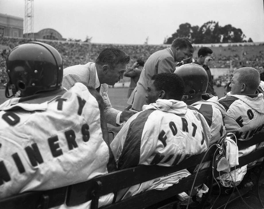 Coach Frankie Albert talks to players as the San Francisco 49ers play the Browns at Kezar Stadium in August 1956. Photo: Bill Young / The Chronicle 1956