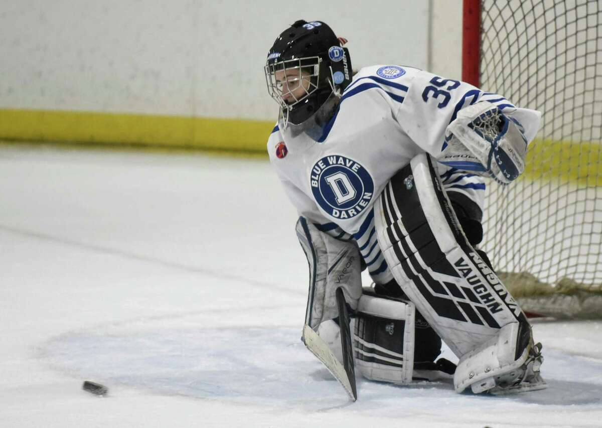 Darien goalie Ella Whitticom (5) makes a save during a girls ice hockey game against Simsbury at the Darien Ice House on Tuesday, Jan. 28, 2020.