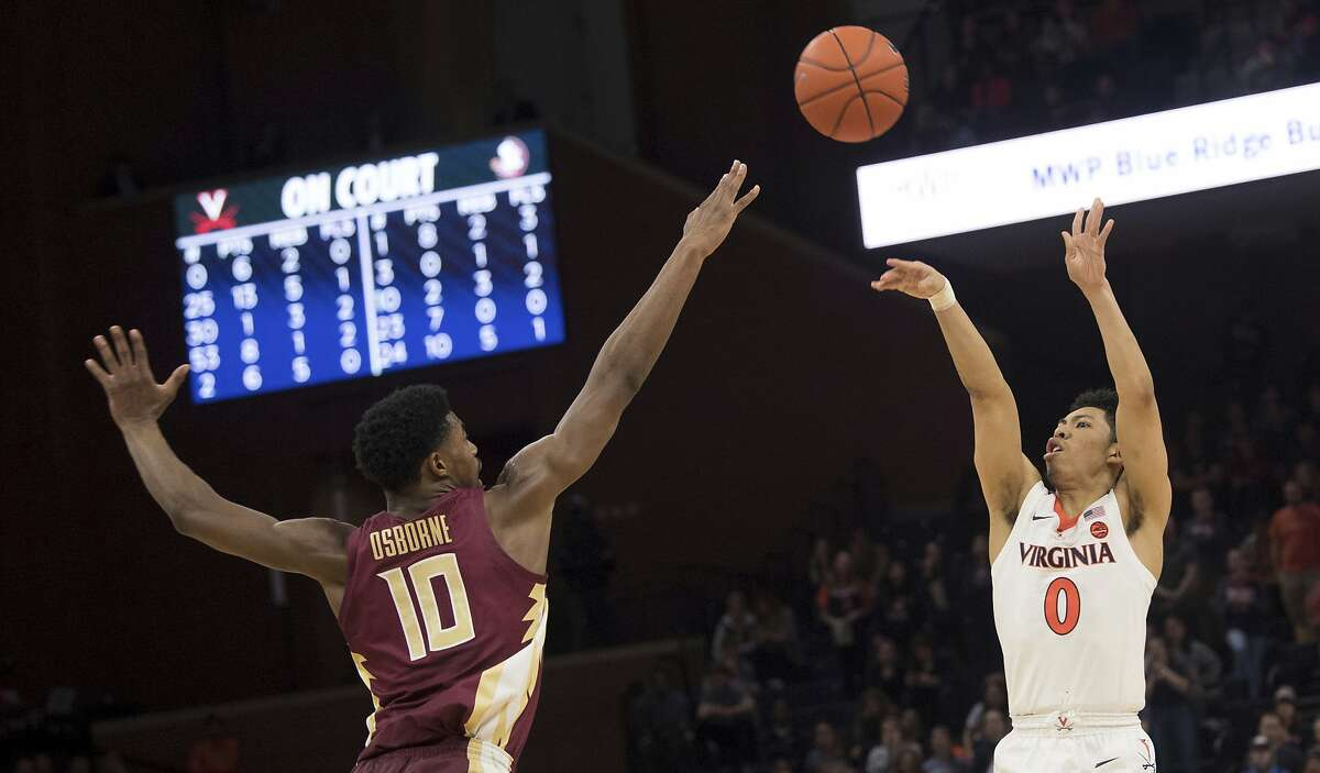 Virginia guard Kihei Clark (0) shoots over Florida State defender Malik Osborne (10) during the second half of an NCAA college basketball game in Charlottesville, Va., Tuesday, Jan. 28, 2020. (AP Photo/Lee Luther Jr.)