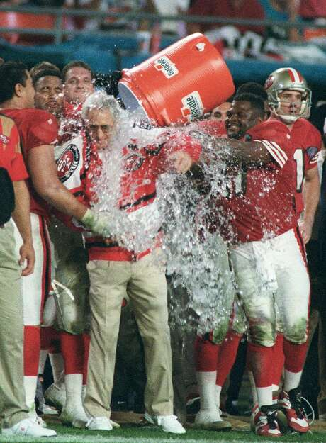 Team members douse coach George Seifert near the end of the Super Bowl victory over the Chargers in January 1995 in Miami. Photo: Lynne Sladky / Associated Press 1995