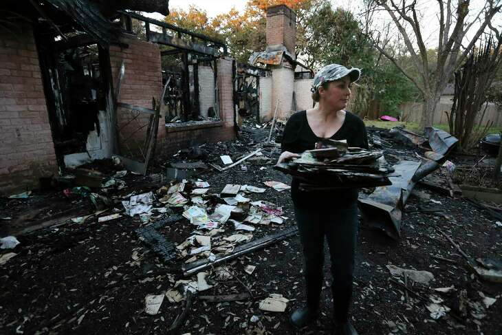 Becky King takes one last look before leaving for the day with salvaged belongings from her mother's home that was destroyed from a lightning-induced fire on Friday, Jan. 24, 2020. King's mother, Margie Miller, 85, managed to escape after lightning struck the house and set fire to her home on Jan. 11 following one of the first major storms of the year. Miller, who was immersed in local theater for the past 40 years, lost not only precious family heirlooms and keepsakes, but a major collection of costumes and memorabilia of her children who all played an important roles in local theater. Miller lived on fixed income and recovery from the fire-damaged home has been made more difficult since she did not have insurance on her home. King and her siblings have started a Go Fund Me account to raise finances to help with the loss.